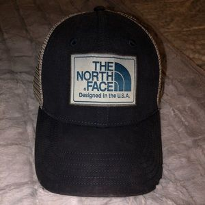 Navy and grey snap back north face hat